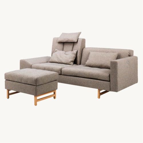 Embrace-Sofa-Bruehl-mit-Hocker